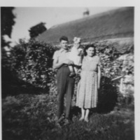 1955 old house my parents with sister.jpeg